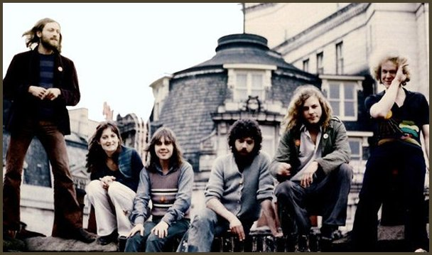 EVERYONE INVOLVED during a rehearsal session in 1972. From left to right: Oskar Lanchester (percussion), Gillian Dickinson (vocals),  Nigel Stewart (keyboards, vocals), Michael Klein (guitar, vocals), Peter Granger (sound engineer), James Asher (drums, violin, piano). (Several key players wouldn't come up to the roof for this picture.)